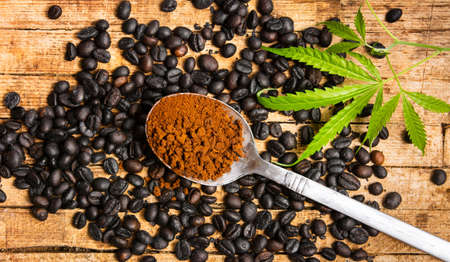 Coffee beans with marijuana and grains in a spoon top view