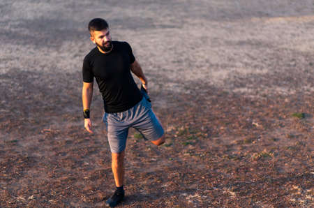 Man stretching before a workout outdoors, healthy lifestyle
