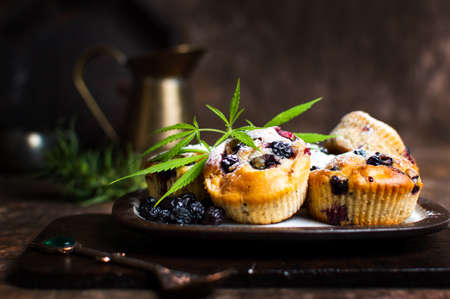 Homemade marijuana muffins with berry fruits 免版税图像