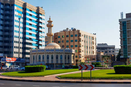 Ajman, United Arab Emirates - December 6, 2018: Mosque in jman downtown by the Corniche road on a sunny day