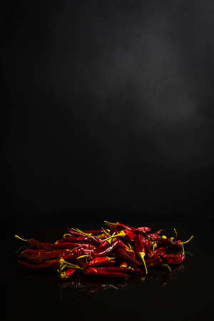 Bunch of dried red peppers on black background 스톡 콘텐츠