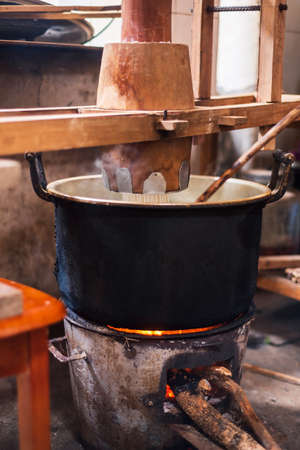 Traditional noodles in making on a vintage manual wooden machine Stockfoto