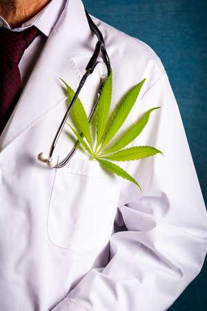 Doctor with a marijuana leaf close up