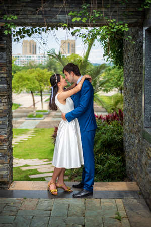 Loving couple hugging in the park pre wedding photo