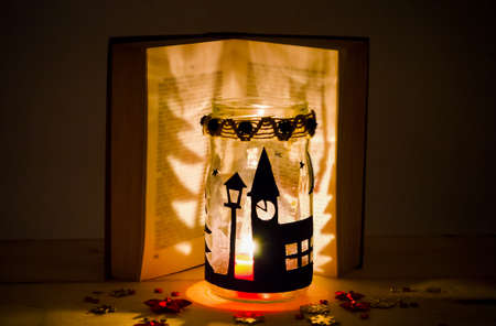 Hand made candle holder and a book Imagens - 116502749