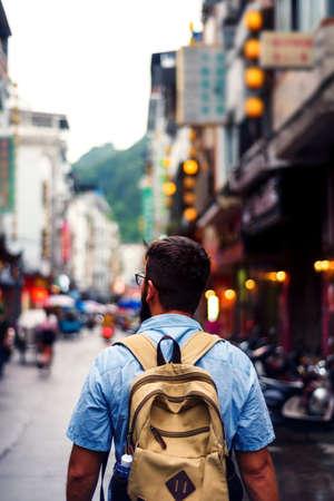 Traveler exploring the streets of Asian food market Фото со стока