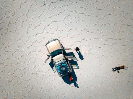 Aerial of a 4x4 car in the salt flats of Uyuni in Bolivia