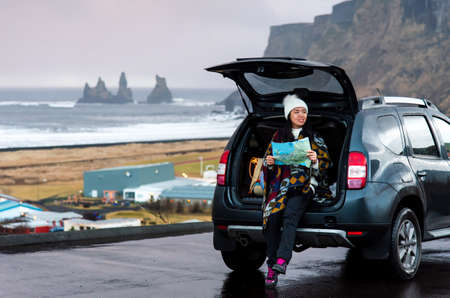Traveler with map planning Iceland trip from the car Stock Photo
