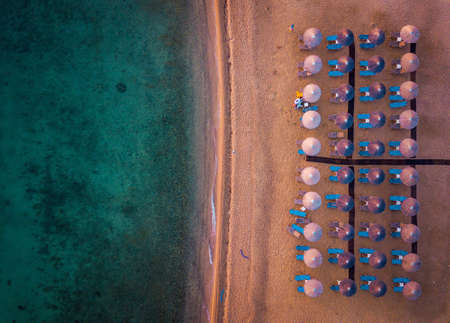 Aerial photo of beach chairs and umbrellas