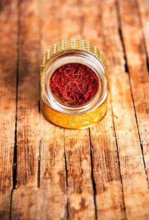 Saffron spice tea crop in a traditional golden colored box