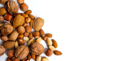 Various nuts on a pile top view, healthy food