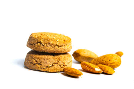 Integral cookies with almonds isolated on white background