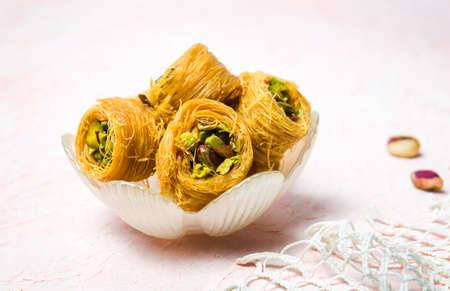 Mabrouma, an Arabic dessert with pistachio on a plate