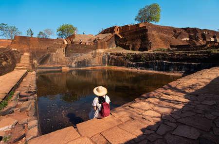 Female traveler visiting Sigiriya rock in Sri Lanka Banco de Imagens