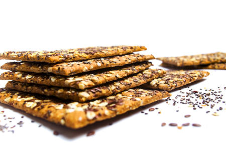 Biscuits with chia seeds and cereals isolated on white 免版税图像
