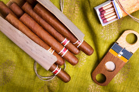 Bunch of Cuban cigars and accessories on a table