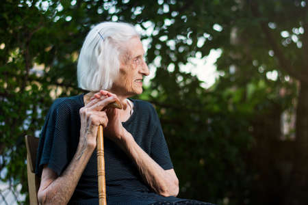 Portrait of a senior woman with a walking cane outdoors Stock Photo
