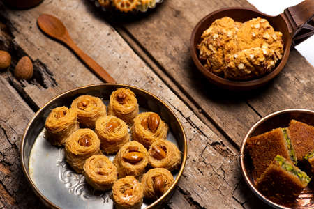 Arabic desserts in rustic bowls top view