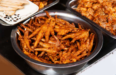 Chicken feet delicatessen snack in China food street Stock Photo