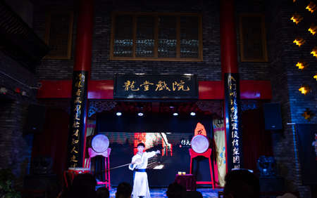 Chengdu, China - July 26, 2019: Artisan tea ceremony performance show at Chinese opera house in Chengdu, Sichuan province of China