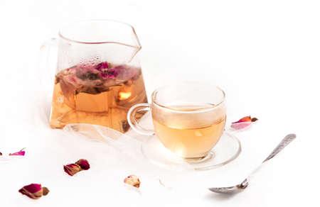 Rose flower herbal tea on white table Standard-Bild - 129461632