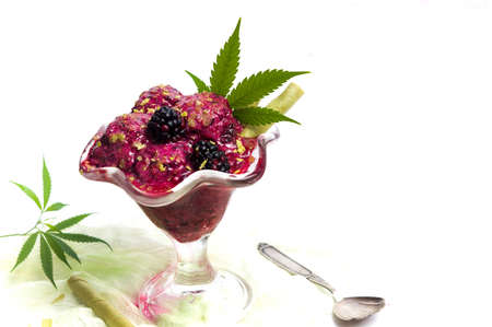 Blackberry fruit ice cream with marijuana in a cup isolated