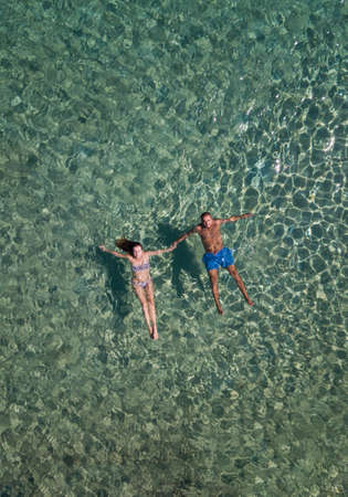 Cute couple floating in the sea aerial