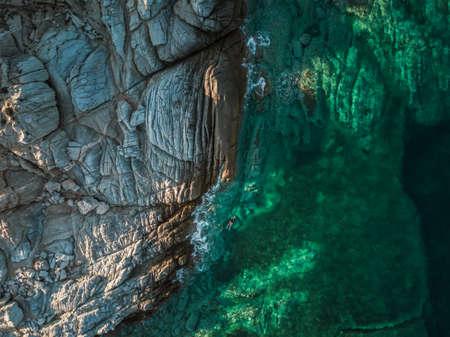 Girl snorkeling in the sea in Greece drone photo