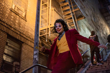 NEW YORK, USA,-NOVEMBER 31,2019: Random person impersonating the Joker and dancing at staircase in the Bronx, New York