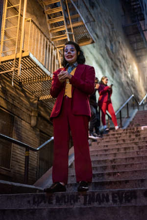 NEW YORK, USA,-NOVEMBER 31,2019: Random person impersonating the Joker and dancing at staircase in the Bronx, New York Sajtókép