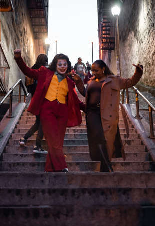 NEW YORK, USA,-NOVEMBER 31,2019: Random people impersonating the Joker and dancing at staircase in the Bronx, New York Sajtókép