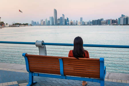 Female tourist enjoying Abu Dhabi cityscape view in the UAE