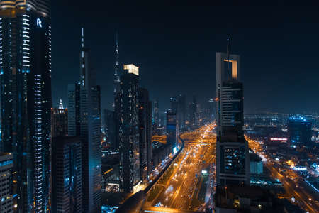 Downtown Dubai modern urban cityscape at night. UAE luxury travel destination