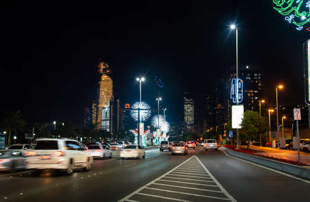 Abu Dhabi, United Arab Emirates - November 27, 2019: Abu Dhabi downtown Corniche road decorated for the United Arab Emirates national day celebration at night