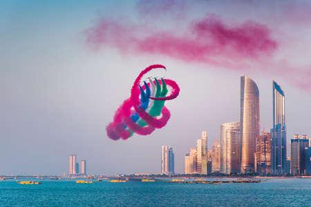 Air show over Abu Dhabi skyline for the United Arab Emirates national day celebration