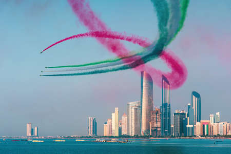 Airplanes flying above Abu Dhabi skyline for the UAE national day celebration air show