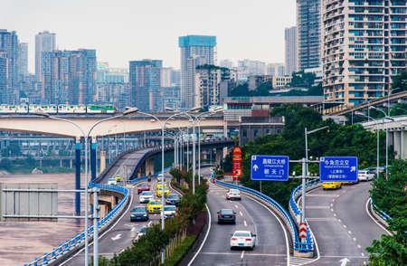 Chongqing, China - July 23, 2019: Multilayer roads and traffic by the Yangtze river in Chongqing, China Sajtókép