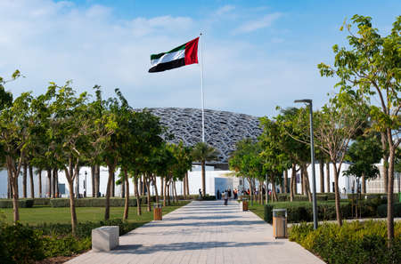 Abu Dhabi, United Arab Emirates - December 20, 2019: Louvre museum in Abu Dhabi exterior and entrance with characteristic architecture on a sunny day