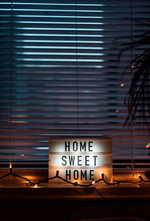 Home Sweet Home sign on the window Stock Photo