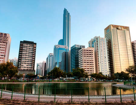 Abu Dhabi downtown cityscape reflected in the water at the Lake park Stok Fotoğraf