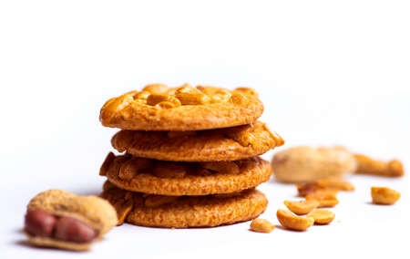 Group of cookies with peanuts on mat.