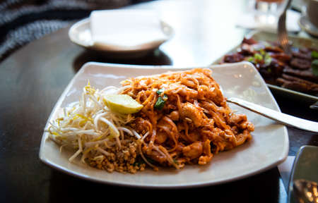 traditional thai food pad thai serviced on a plate on the table