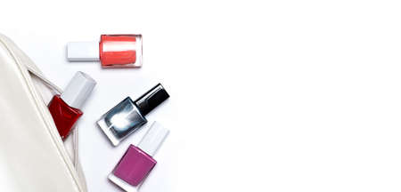 Nail polish bottles collection in various colors on white background