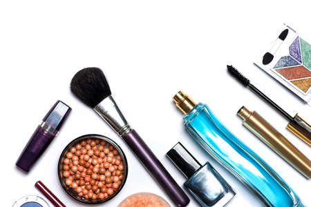 Makeup and cosmetic products isolated on white flat lay. Nail polish blush balls with brushes perfumes lipstick an other accessories