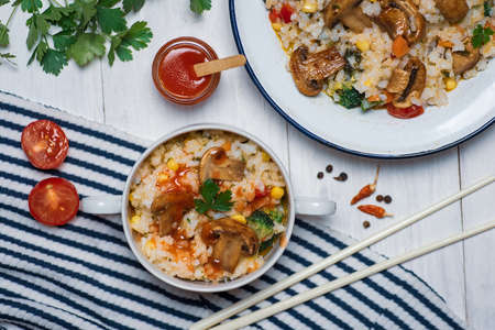 Homemade vegetarian risotto with mushrooms and vegetables on a plate Stok Fotoğraf