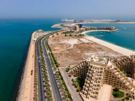 Man made Marjan Island in emirate of Ras al Khaimah in the United Arab Emirates aerial view at sunrise of the characteristic architecture and waterfront Stok Fotoğraf