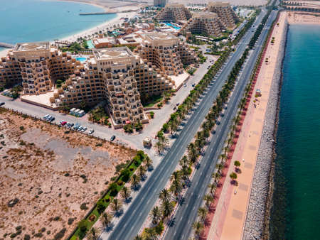 Marjan Island in emirate of Ras al Khaimah in the United Arab Emirates aerial view at sunrise of the characteristic man shaped skyline and waterfront architecture