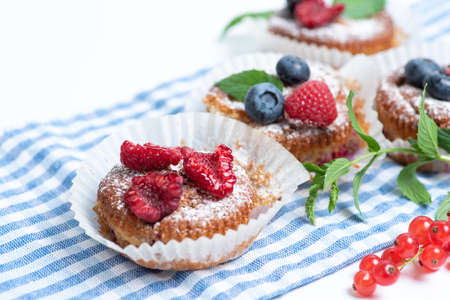 Mixed berry fruit muffins with raspberry blackberry and blueberry isolated