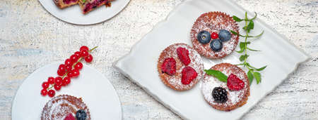 Mixed berry fruit muffin desserts on a plate top view