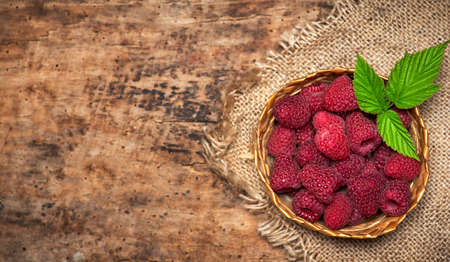 fresh raspberry red berry fruit in a bowl